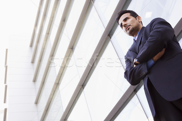 Businessman standing outside office building Stock photo © monkey_business