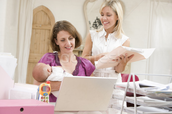 Two women and a baby in home office with laptop Stock photo © monkey_business