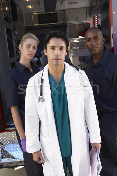 Portrait of doctor with two paramedics in front of ambulance Stock photo © monkey_business