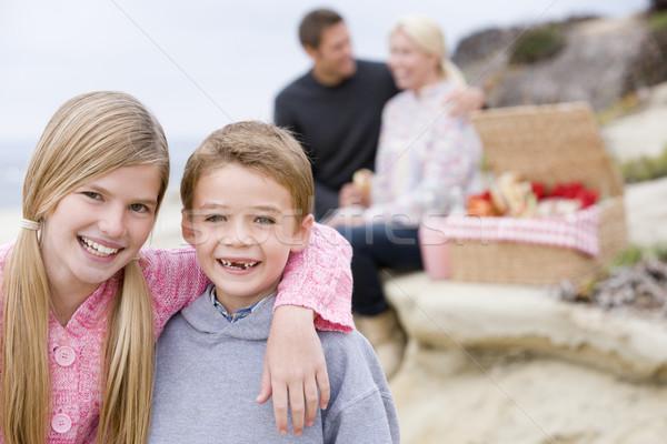 Сток-фото: семьи · пляж · пикника · улыбаясь · ребенка · морем