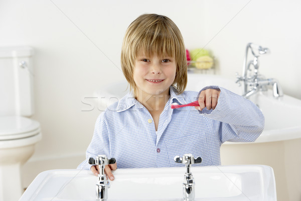 Young Boy Brushing Teeth at Sink Stock photo © monkey_business