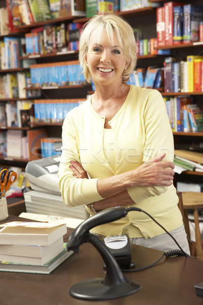 Homme librairie propriétaire femme livre magasin Photo stock © monkey_business
