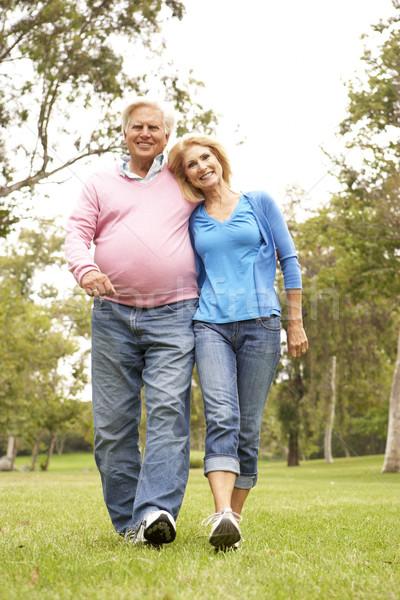 Idős pár sétál park férfi boldog pár Stock fotó © monkey_business