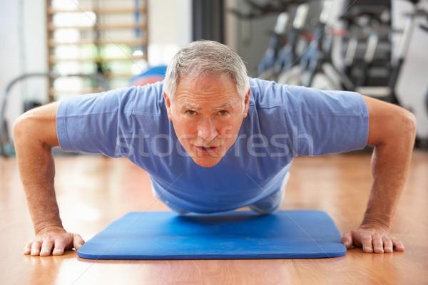 Senior Man Doing Press Ups In Gym Stock photo © monkey_business
