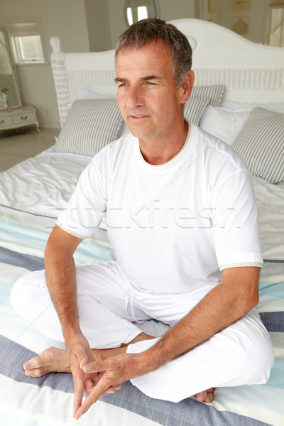 Mid age man in lotus position Stock photo © monkey_business