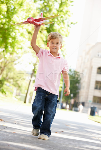 Young boy in street with toy aeroplane Stock photo © monkey_business