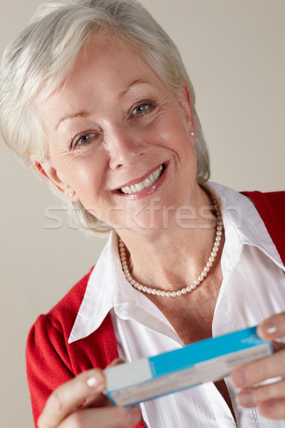 Senior woman holding prescription drug pack Stock photo © monkey_business