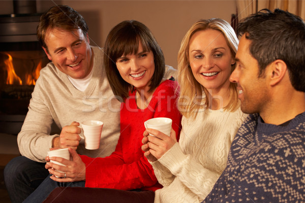 Group Of Middle Aged Couples Sitting On Sofa With Hot Drinks Tal Stock photo © monkey_business
