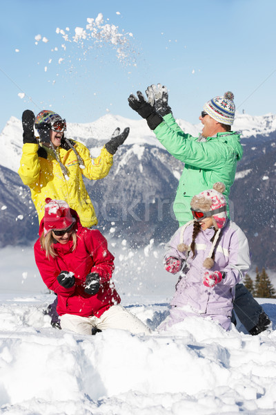 Teenage Family Having Snow Fight In Mountains Stock photo © monkey_business