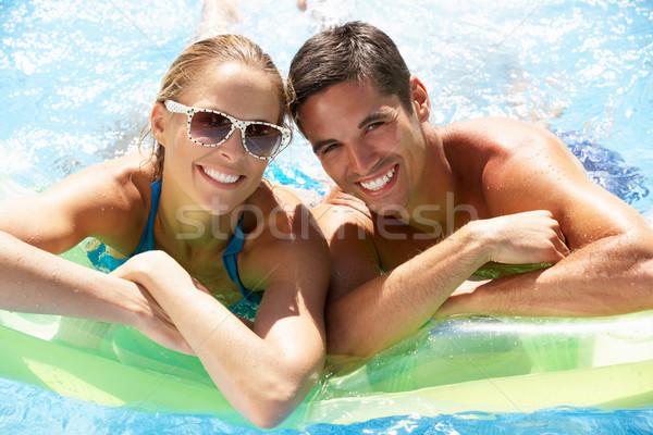 Stock photo: Couple Having Fun In Swimming Pool