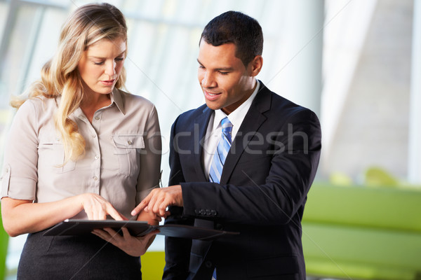 Businessman And Businesswomen Having Informal Meeting In Office Stock photo © monkey_business
