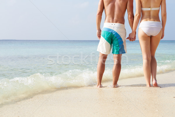 Detail paar holding handen strandvakantie strand liefde Stockfoto © monkey_business