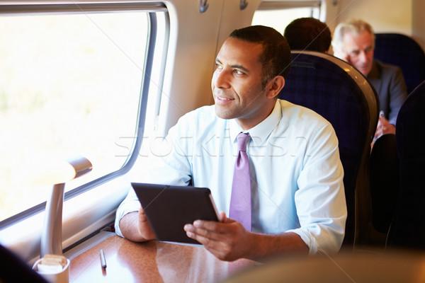 üzletember ingázás vonat digitális tabletta technológia Stock fotó © monkey_business