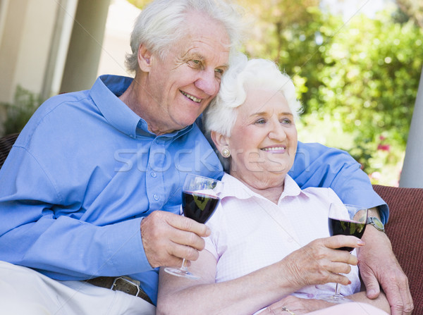 Stock photo: Senior couple relaxing with glass of wine