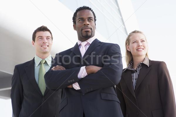Stockfoto: Drie · zakenlieden · permanente · buitenshuis · gebouw · glimlachend