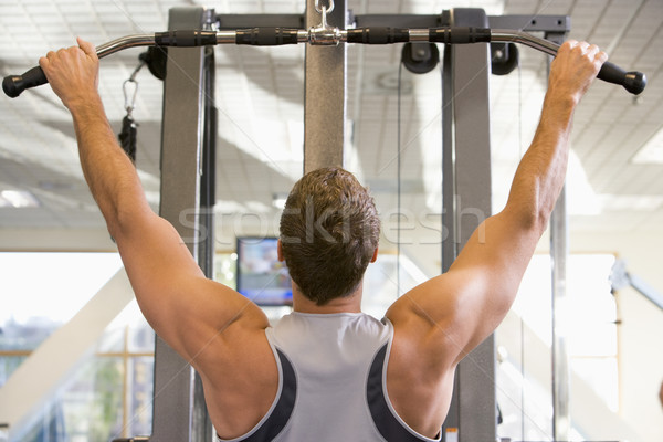 Man Weight Training At Gym Stock photo © monkey_business