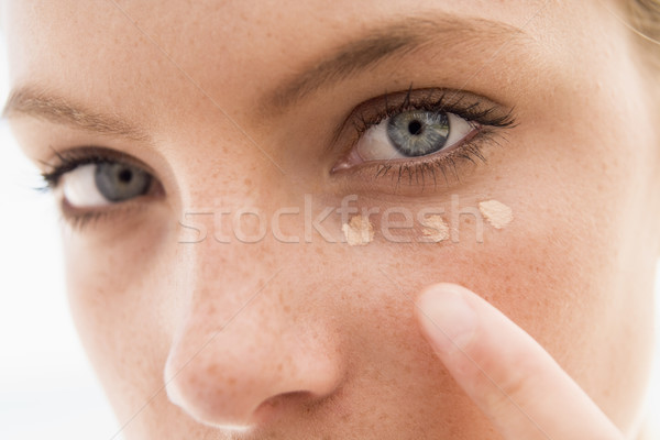 Woman applying concealer Stock photo © monkey_business