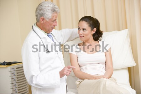 Stock photo: Doctor Talking To Senior Man And His Wife