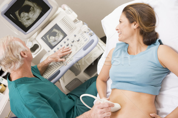 Doctor Giving Patient An Ultra Sound  Stock photo © monkey_business