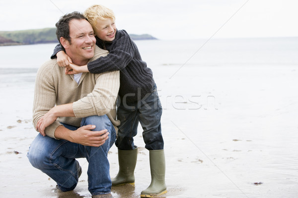 Père en fils plage souriant enfant mer hiver Photo stock © monkey_business