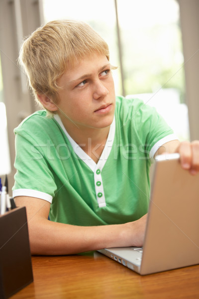 Guilty Looking Teenage Boy Using Laptop At Home Stock photo © monkey_business