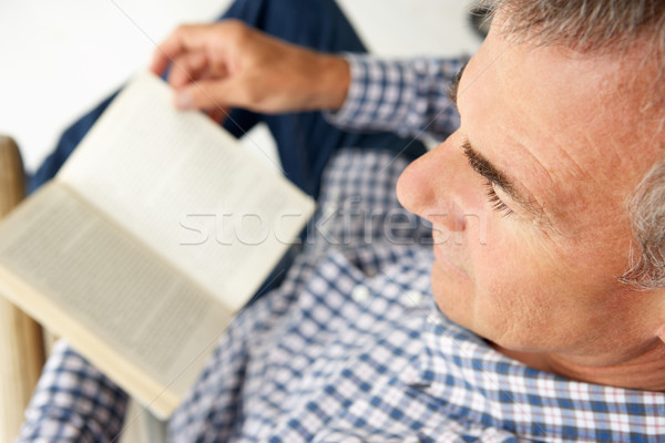 Mid age man reading a book Stock photo © monkey_business