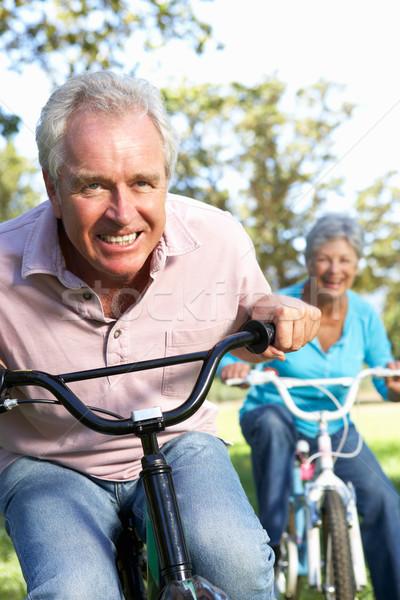 Idős pár játszik biciklik boldog pár nyár Stock fotó © monkey_business
