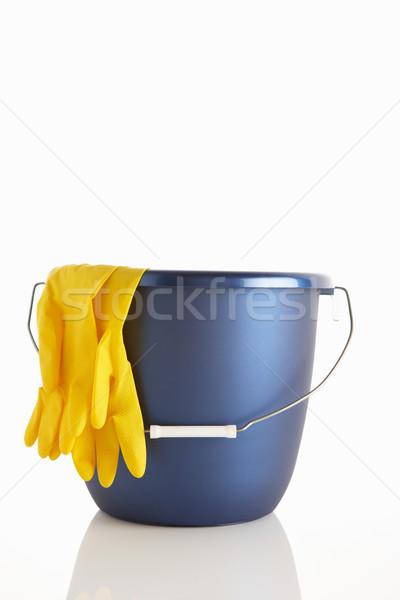 Balde luvas de borracha limpeza limpar estúdio amarelo Foto stock © monkey_business
