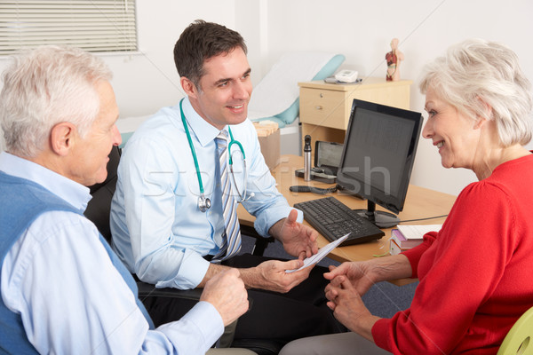British GP talking to senior couple in surgery Stock photo © monkey_business