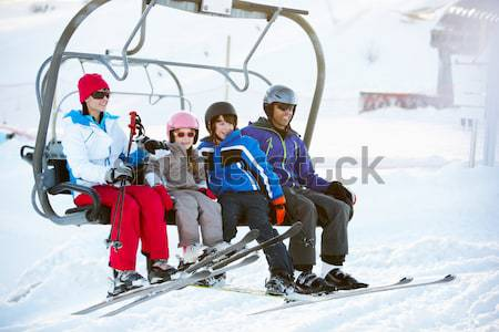 Stock photo: Family Getting Off chair Lift On Ski Holiday In Mountains