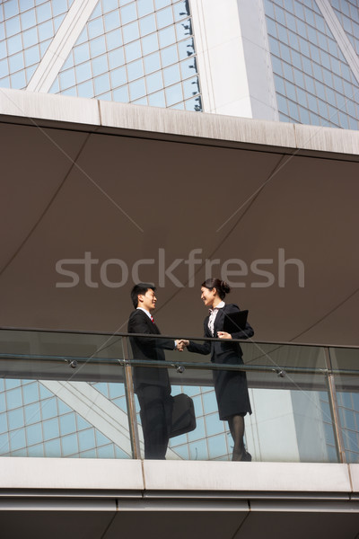 Two Business Colleagues Shaking Hands Outside Office Building Stock photo © monkey_business