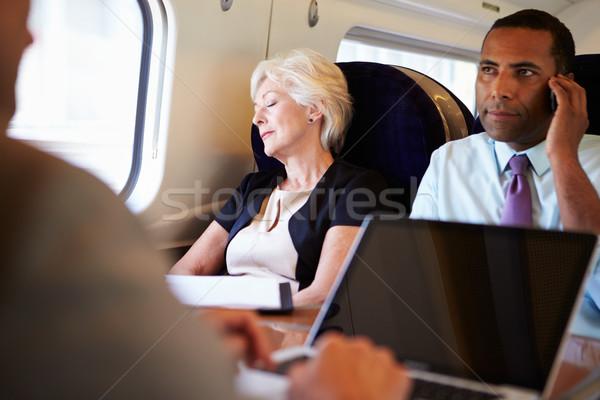 üzletasszony pihen vonat utazás férfi nők Stock fotó © monkey_business