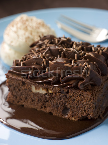 Chocolate Fudge Brownie With Chocolate Fudge Sauce And Cream Stock photo © monkey_business