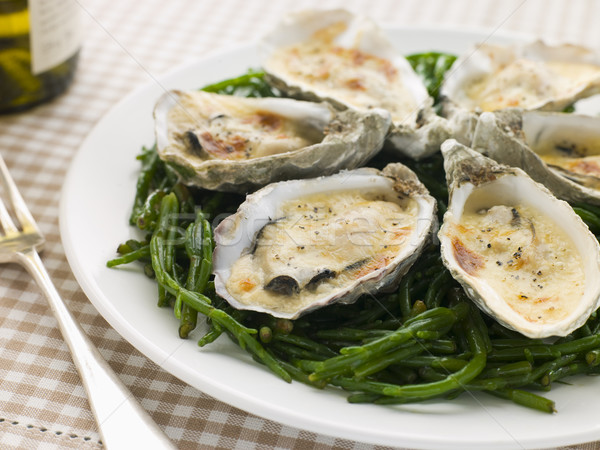 Grilled Oysters with Mornay Sauce on Samphire Stock photo © monkey_business