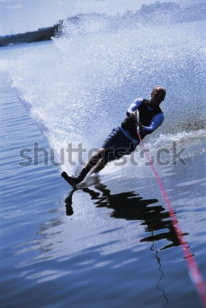Stock photo: A young man water skiing