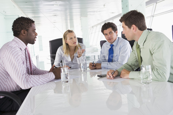 Four businesspeople in a boardroom talking Stock photo © monkey_business