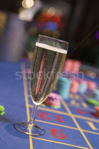 Close up of champagne glass on roulette table Stock photo © monkey_business
