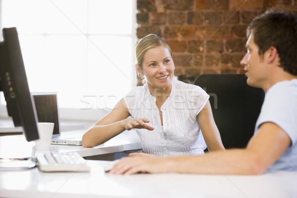 Deux gens d'affaires bureau parler souriant affaires Photo stock © monkey_business