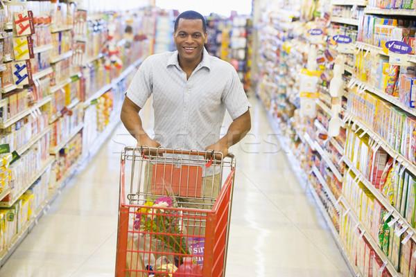 человека супермаркета проход продуктовых продовольствие Сток-фото © monkey_business
