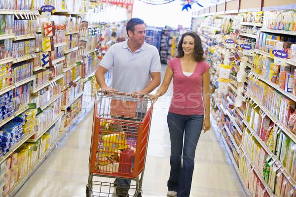 Pár vásárlás áruház folyosó élelmiszer nő Stock fotó © monkey_business