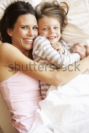 Couple laying on a bed Stock photo © monkey_business