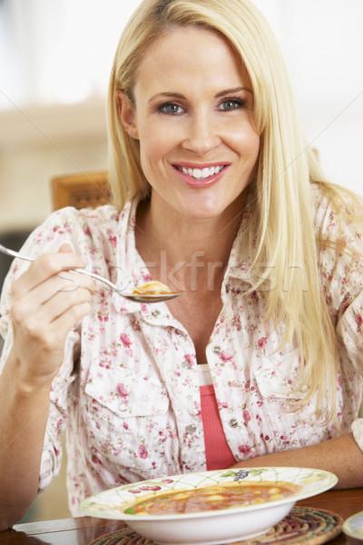 Сток-фото: взрослый · женщину · еды · суп · улыбаясь · камеры