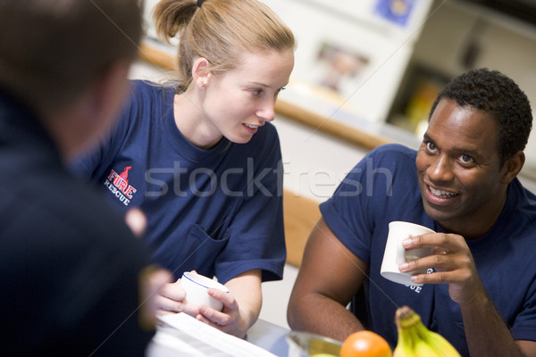 Firefighters relaxing in the staff kitchen Stock photo © monkey_business