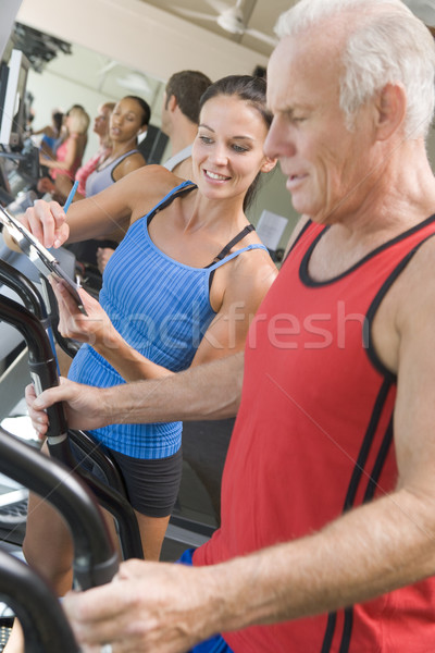 Personal Trainer Instructing Man On Treadmill Stock photo © monkey_business
