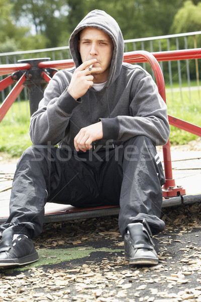 Young Man Sitting In Playground Smoking Joint Stock photo © monkey_business