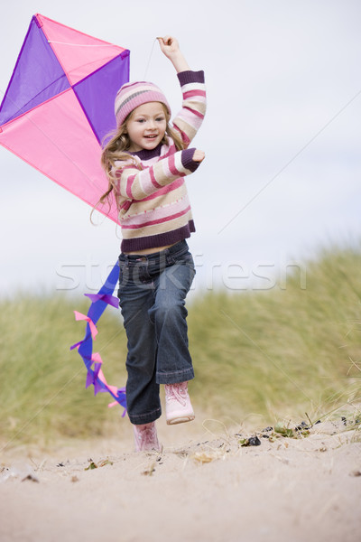 Jong meisje strand Kite glimlachend kind winter Stockfoto © monkey_business