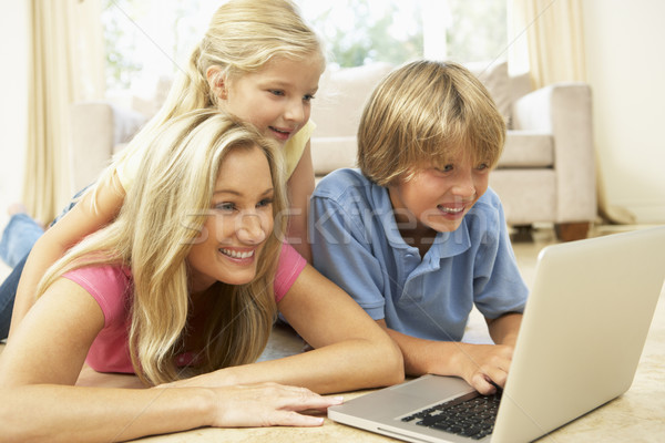 Mother And Children Using Laptop At Home Stock photo © monkey_business