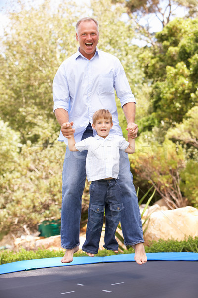 Father And Son Jumping On Trampoline In Garden Stock photo © monkey_business