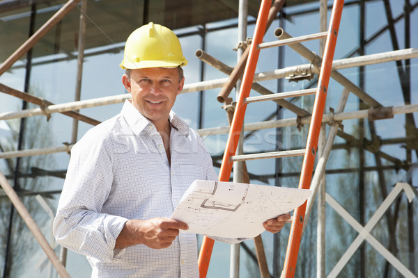 Stock photo: Architect Studying Plans Outside New Home