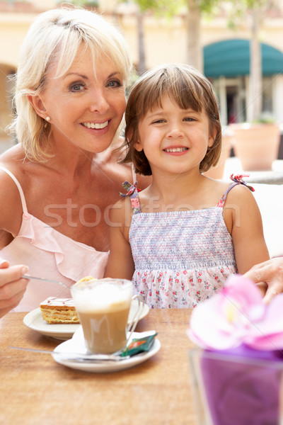 Grandmother With Granddaughter Enjoying Coffee And Cake In Caf Stock photo © monkey_business